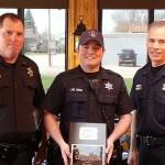 (Center:  Galesburg Police Officer Lane Mings.)