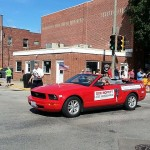 (State Rep. Don Moffitt walks the Labor Day Parade Monday in Galesburg.)
